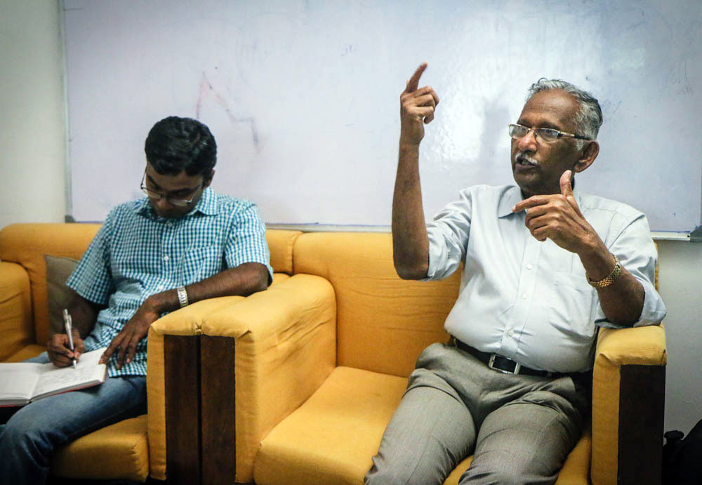 Venugopal sharing some of his insights from 50 years experience in the Indian film industry while a diligent student takes notes.