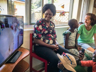 TLM Psychosocial Manager, Beatrice Millinga (center), and TLM Program Director, Dr. Trish Scanlan (right), enjoying watching the films with the students.